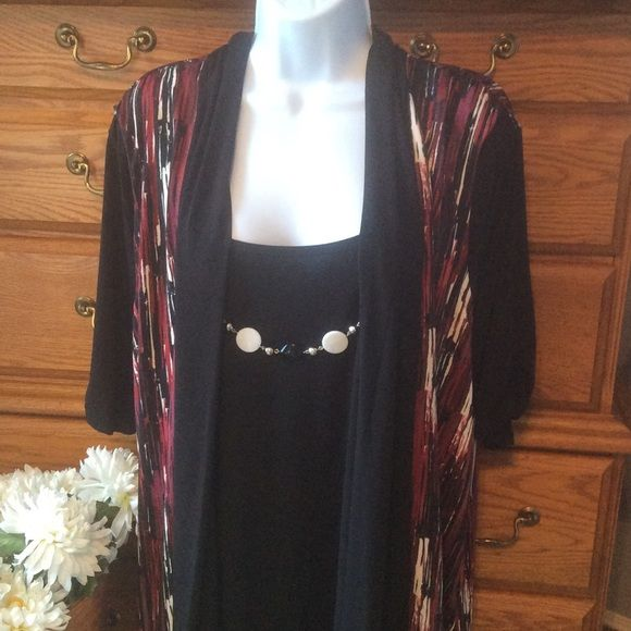 "Notations Dressy All In One Tunic NWT Colors of black creamy white along with burgundy and reds.  95% polyester and 5% spandex.  Brand new.  Has attached necklace that can be removed.  Short sleeve with the tank cardigan look over it but it is one piece.  Feels like a liquid knit.  Light weight and comfy.  Approximately 28"" in length and when laid flat from armpit to armpit it measures 25"" across. Notations Tops Tunics"