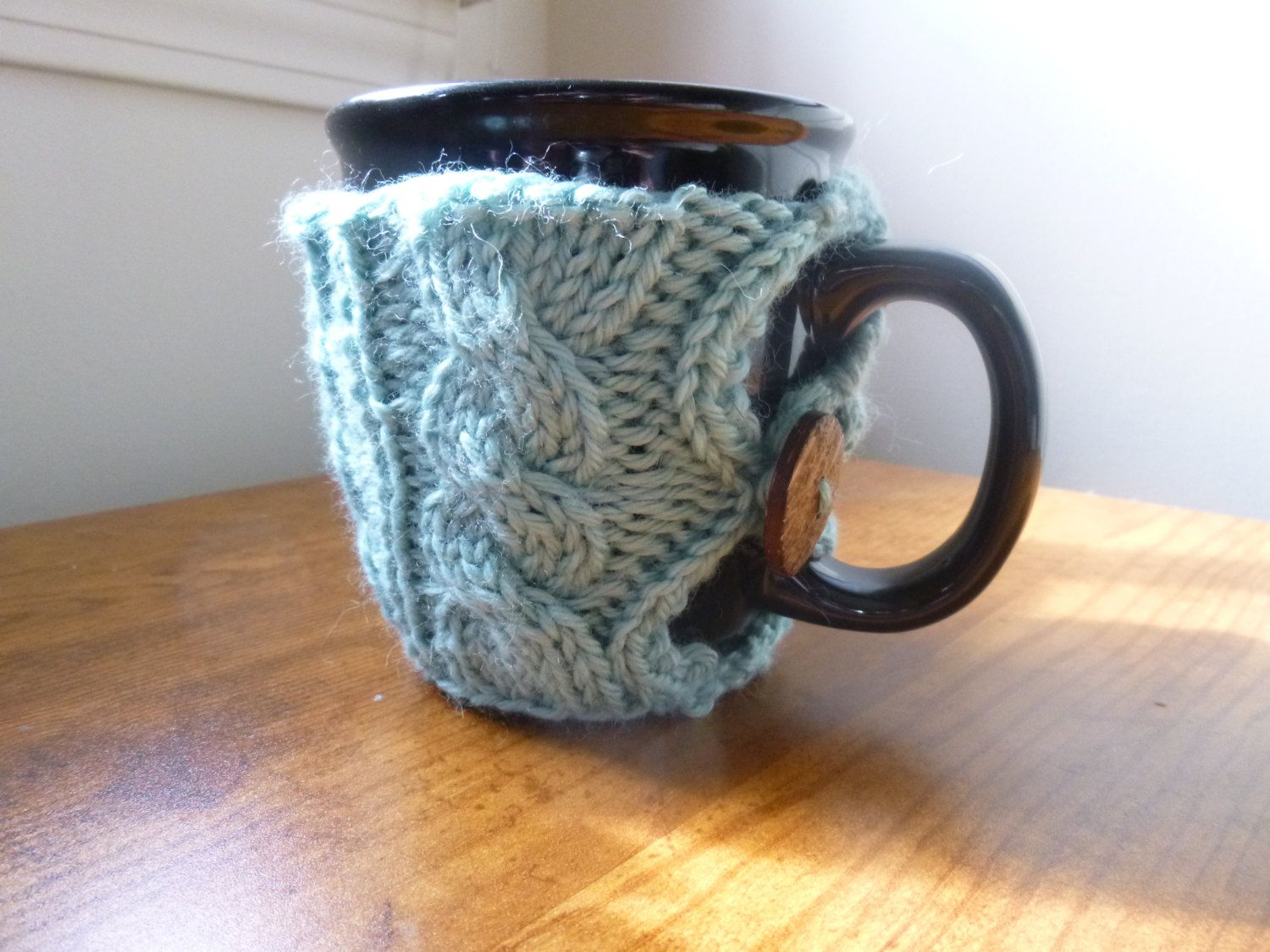 Hand knit tea/coffee cup cozy by LittleBoPress on Etsy https://www.etsy.com/listing/166332437/hand-knit-teacoffee-cup-cozy