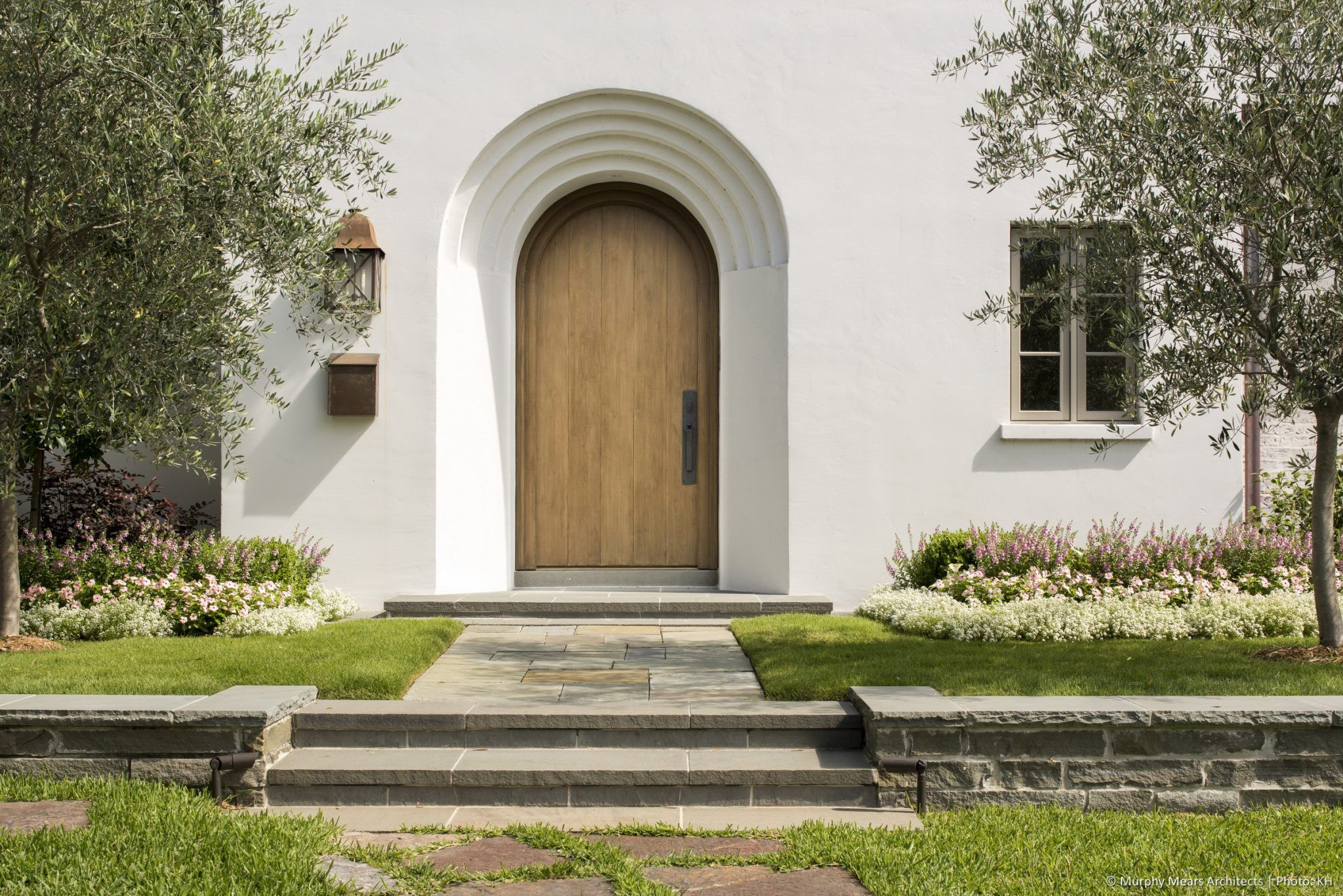 Solid Wood Front Entry Door Accessed From A Raised Front Garden