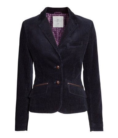 Fitted corduroy blazer with imitation leather details. One chest pocket and  pockets at front with flap.