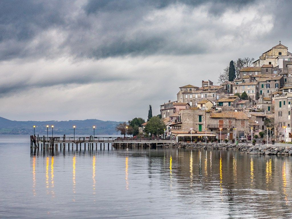 Twenty miles northwest of Rome, Lake Bracciano owes its origins to volcanic activity thousands of years ago. Today, it is one of the cleanest lakes in Italy due to strict monitoring from officials and its status as a drinking water reservoir for Rome.
