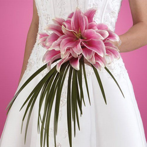 http://www.wedding-flowers-and-reception-ideas.com/stargazer-lily.html  stargazer lily arrangement...I would want a deeper red but I like the palm tree-ish adornment...straight lines...