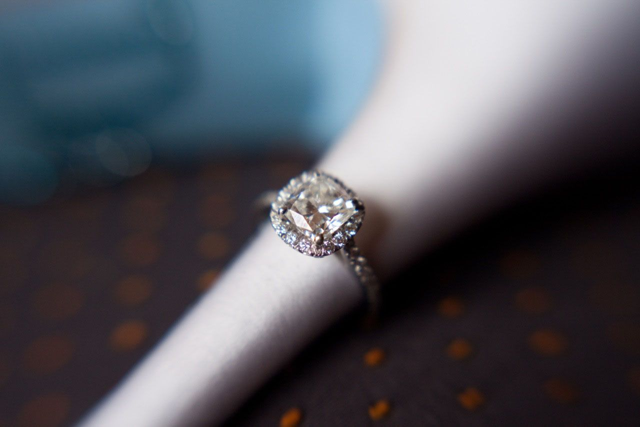 A gorgeous custommade diamond and platinum engagement ring hand