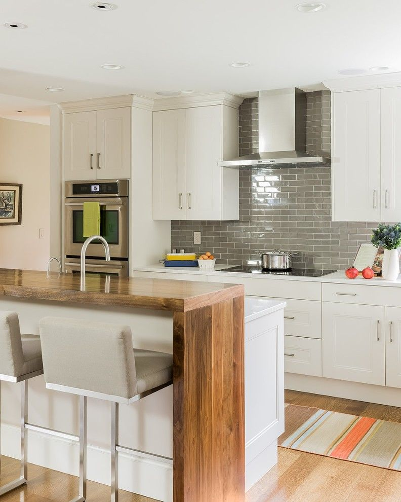 Added Wooden Table For Bar Seating With Metal Stools With Backs Covered With Grey Cushion Waterfall Countertop Open Plan Kitchen Dining Raised Kitchen Island