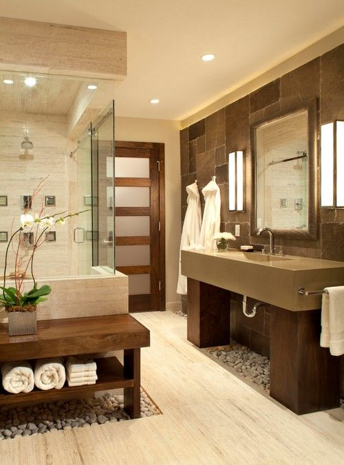 Zen bathroom lighting ideas and advice zen bathroom online blog this spa like bathroom designed by ashley campbell interior design features loose river rocks in a lighted channel and a custom bench and door aloadofball Choice Image