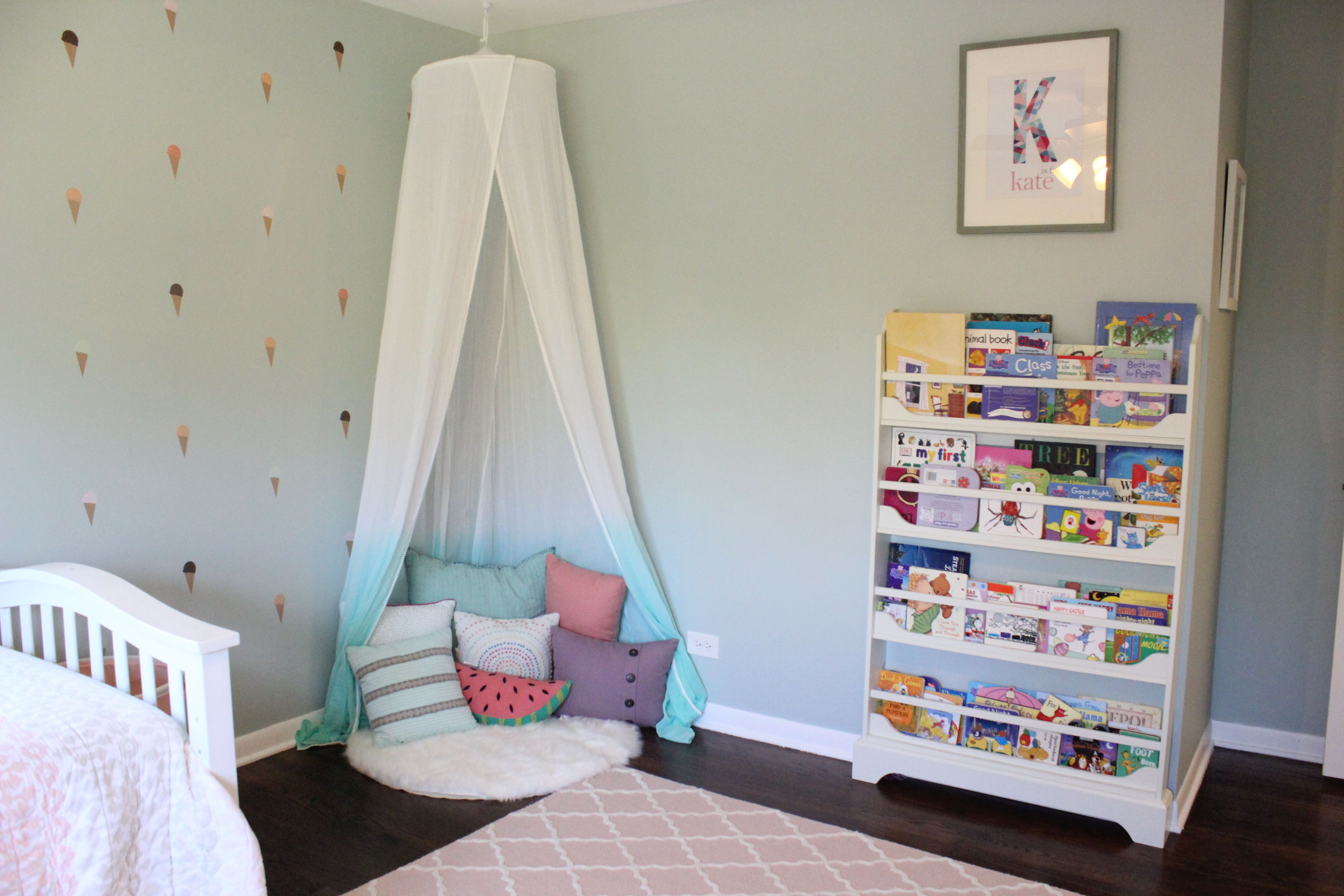 Reading Nook With Canopy And Bookshelf In Girls Room