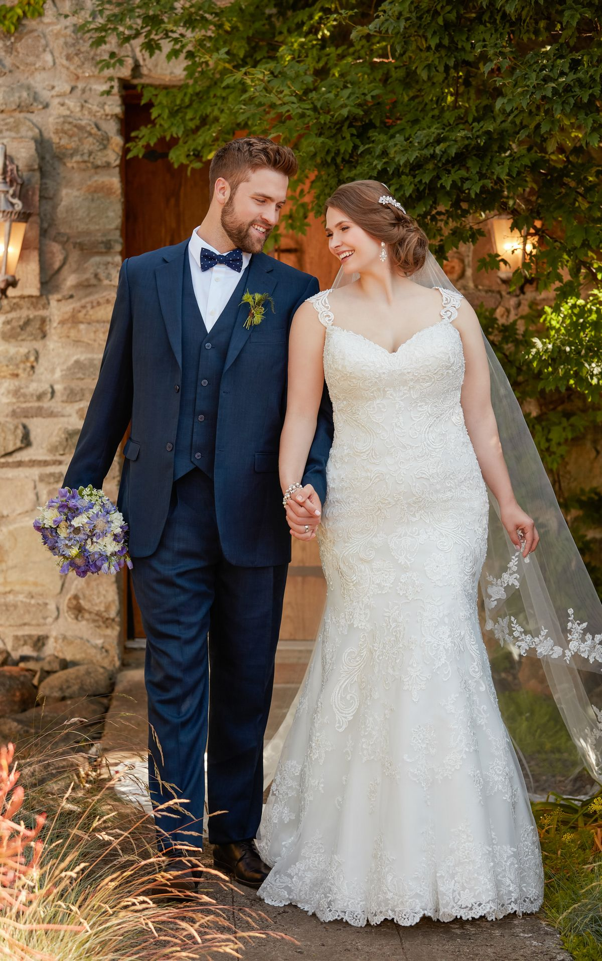 Beaded fit and flare plus size wedding dress with silver lace