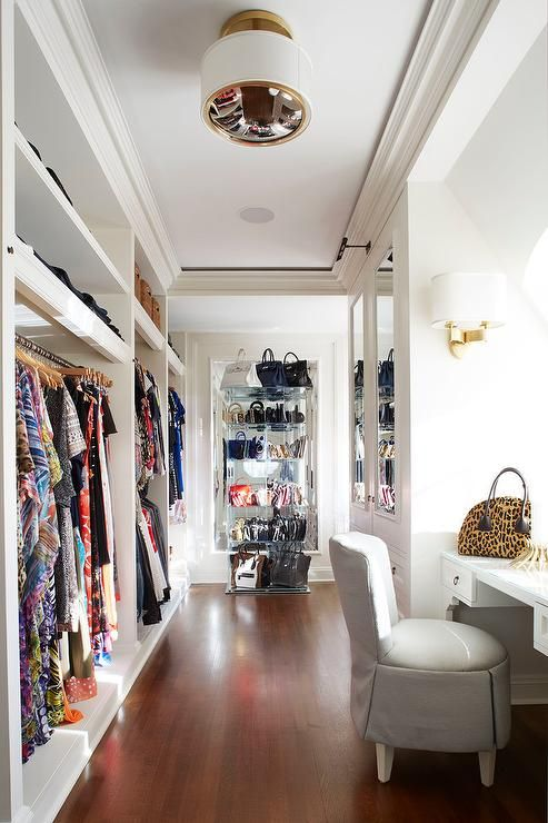 A Large Walk In Closet Is Every Girl Dream, Especially When Accompanied  With Lucite Shelving Unit Displaying Designer Handbags.