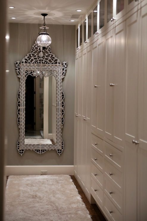 Glamorous Walk In Closet With Venetian Floor Mirror Gray Walls