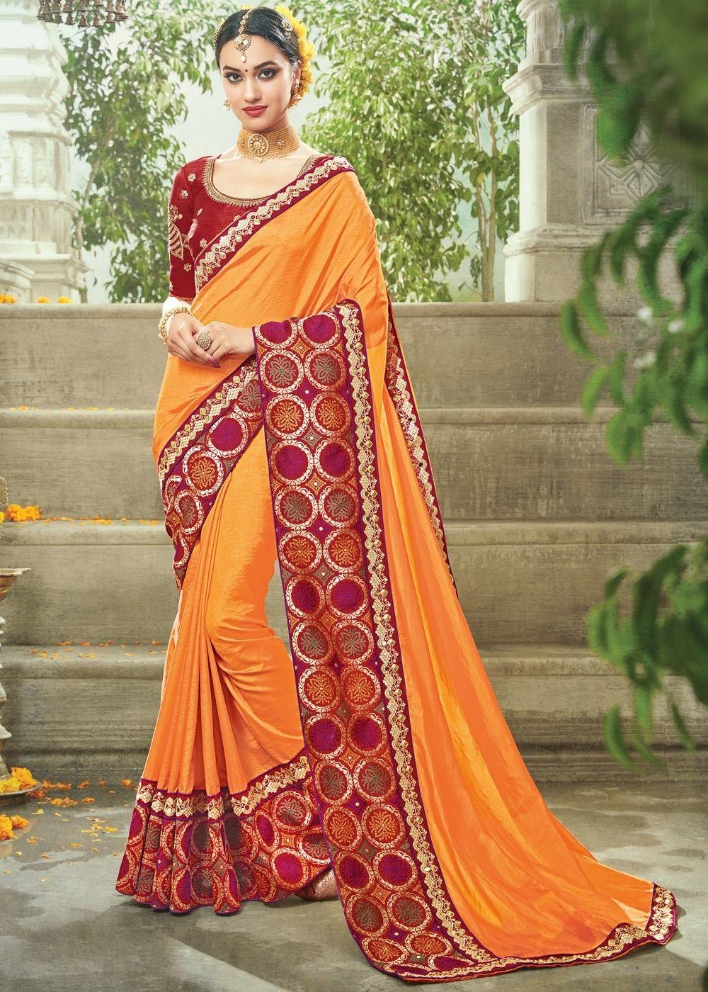 82ab19c742fff  Orange  banarasi  silk  saree richly crafted zari brocade border and zari  embellished art silk blouse.