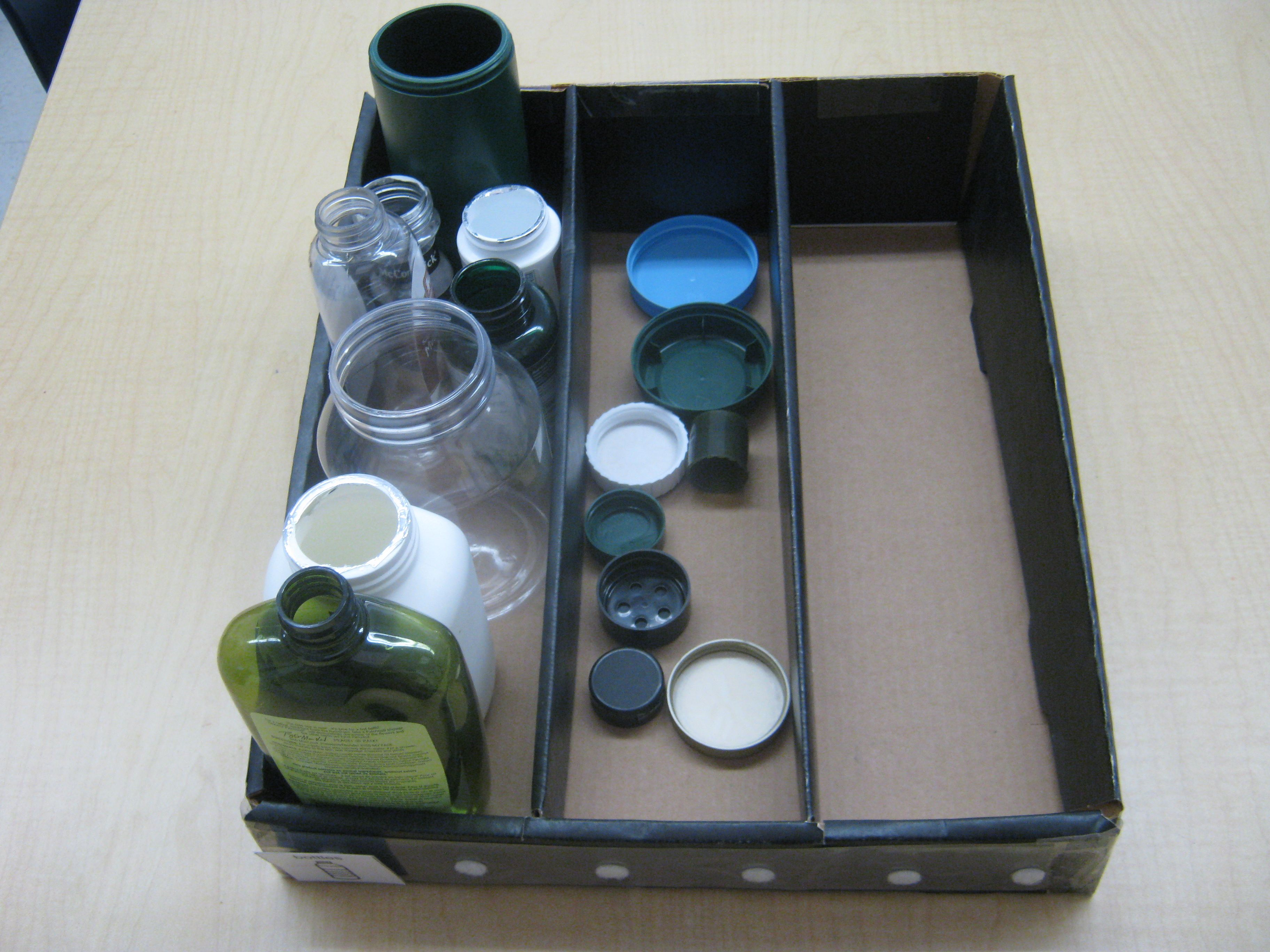 Organized Task Where Students Match And Screw Lids Onto Bottles