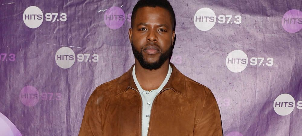 Winston Duke How One Can Gown Like The Subsequent Great Point Neutral Shirt Grandad Collar Shirt Brown Suede Jacket
