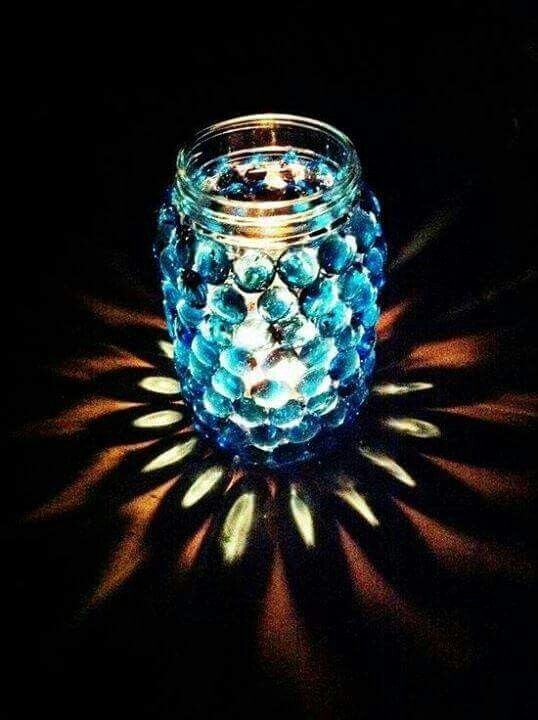 Blue giant glass pebbles to the outside of a jar   (find on