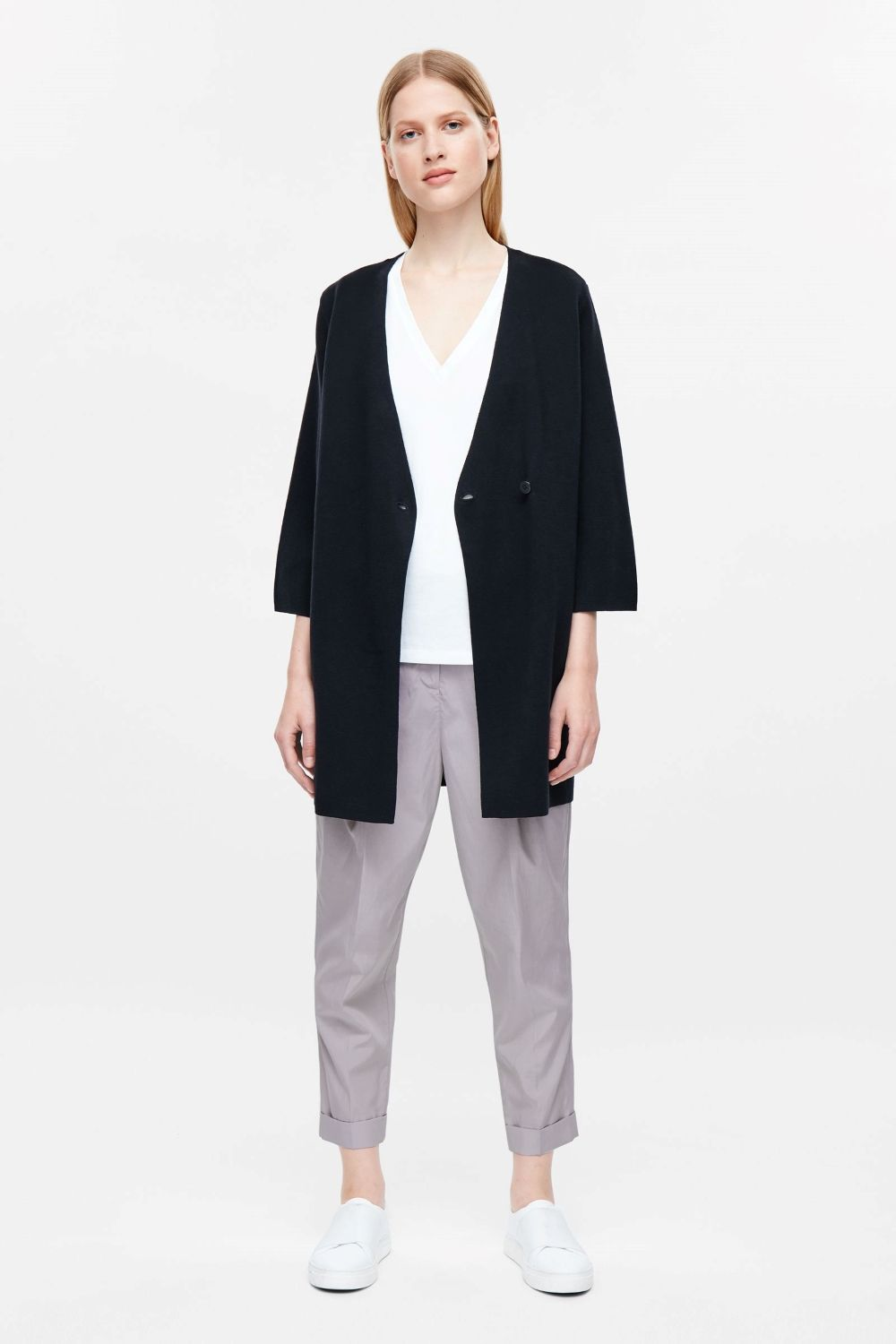 Made from a milano knitted cotton, this cardigan has a overlapping front with a simple button fastening. A relaxed fit, it has a deep v-neckline, wide sleeves and modern, clean-cut finishes.