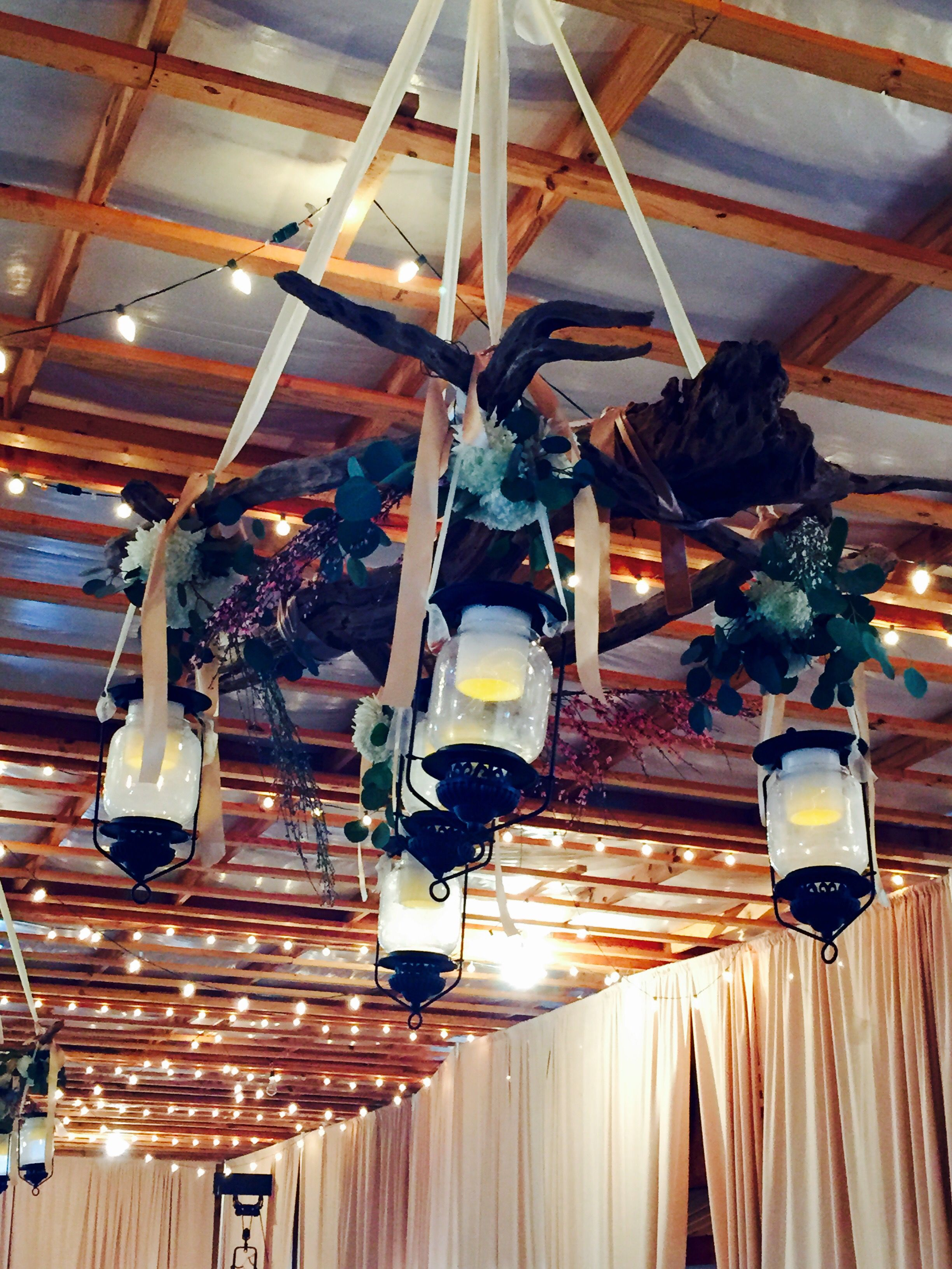 Battery Candles flipped upside down in Lanterns in a Wedding Reception Driftwood Chandelier!