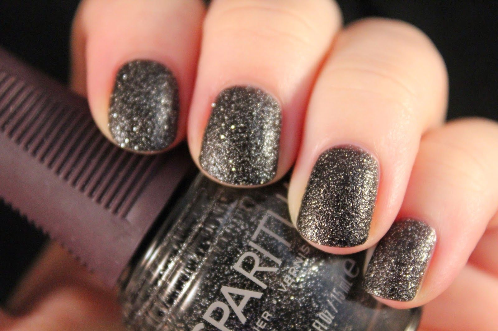 Sparitual Jazz is our neutral polish today.  I wasn't aware when I purchased it- but this dries to a textured finish- it was a nice surprise.  It's a very dark gray- almost black- that has tons of silver shimmer running throughout.  You can do one coat, but I've shown you two.  A