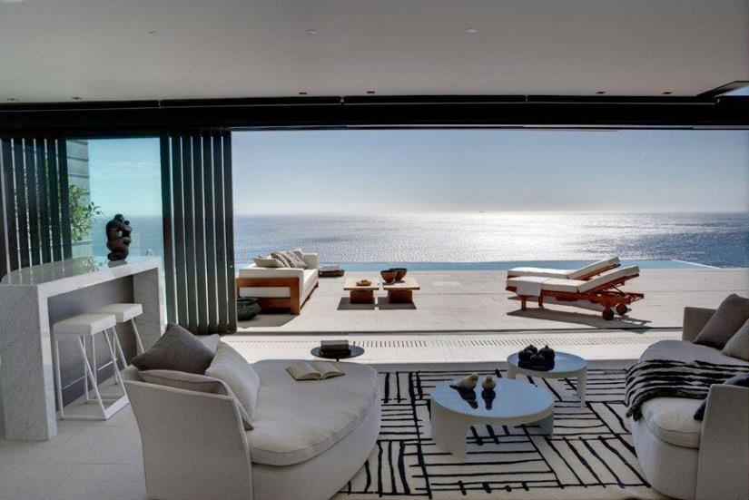 Living room with infinity pool and sea view