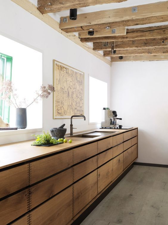 Exposed Beams Instantly Gives This Minimalist Kitchen An #industrial Feel