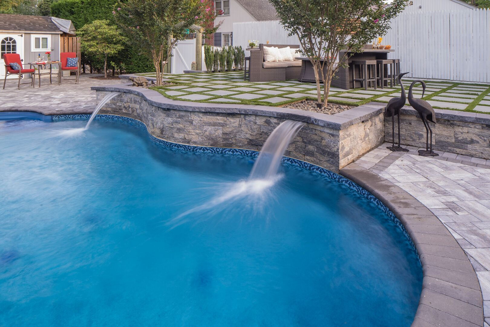 Add A Waterfall To Your Pool Patio To Make It Even More Unique
