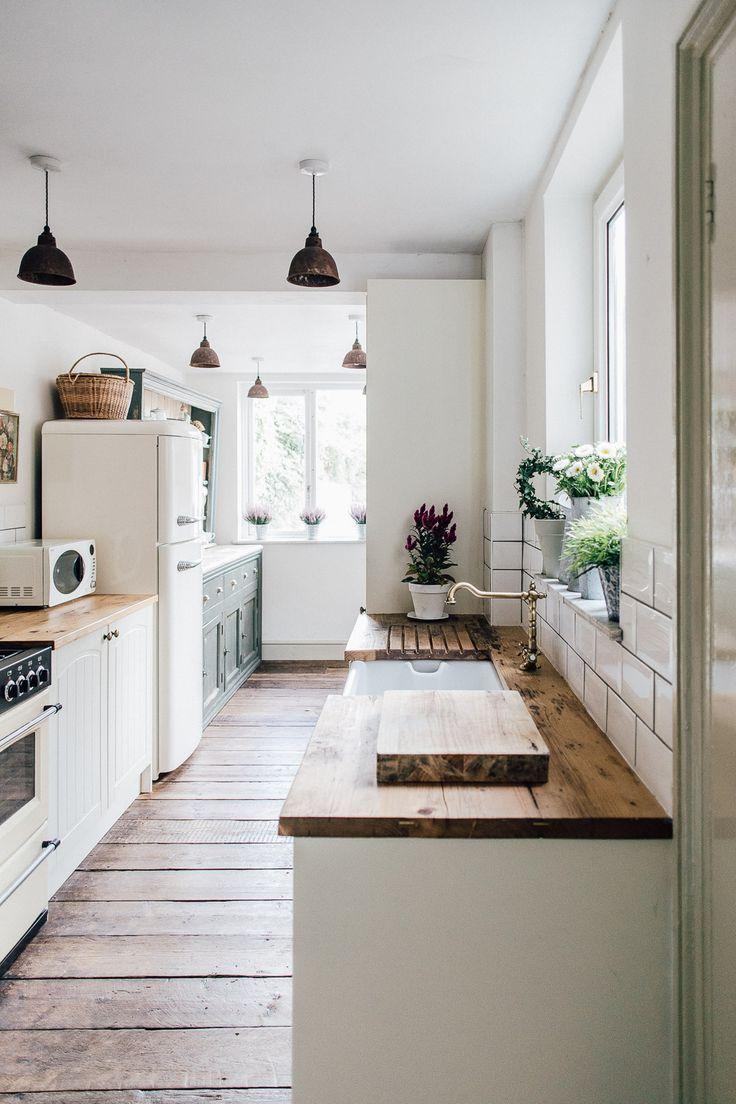 Farmhouse minimalist kitchen with wood flooring, white