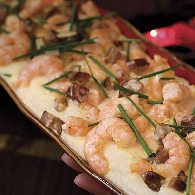 Cajun Christmas Eve  This marvelous meal is full of spicy Louisiana flair. Gather family, invite friends, kick back, and relax—Cajun style.        Cajun Green Bean Stir-fry      Cajun Bread Knots      Satsuma Salad      Shrimp and Andouille Sausage With Asiago Grits (pictured)      Asiago Grits      Pineapple-Apple Bread Pudding With Bourbon Sauce