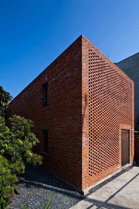 Perforated brickwork used to renovate house in vietnam for Perforated brick wall