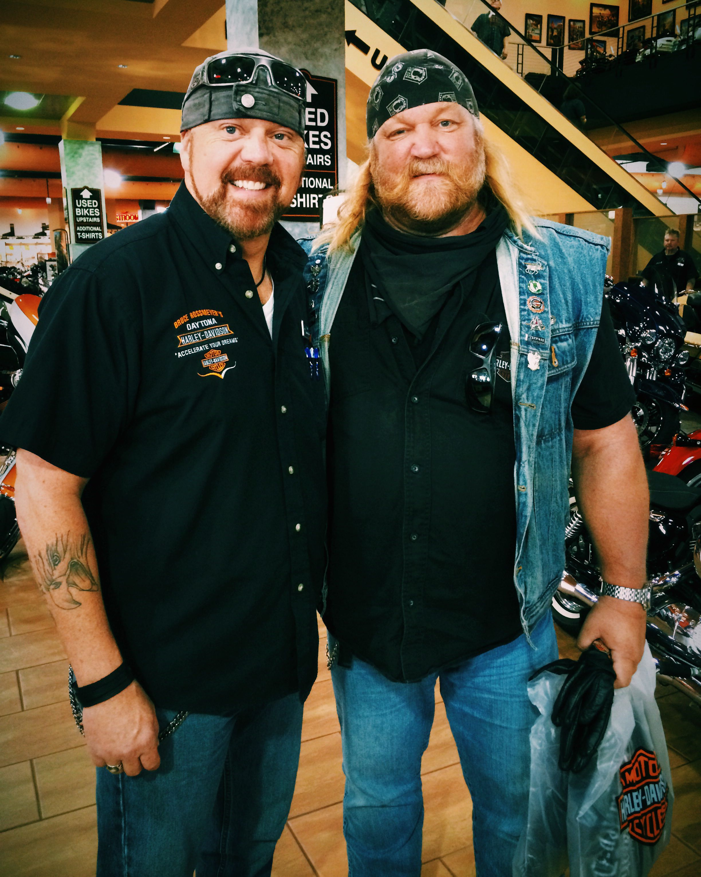 """stan ellsworth of """"american ride"""" with an employee at bruce"""