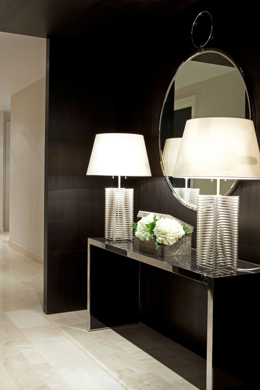 Love the idea of a thin hall table with lighting and a large mirror behind the table.