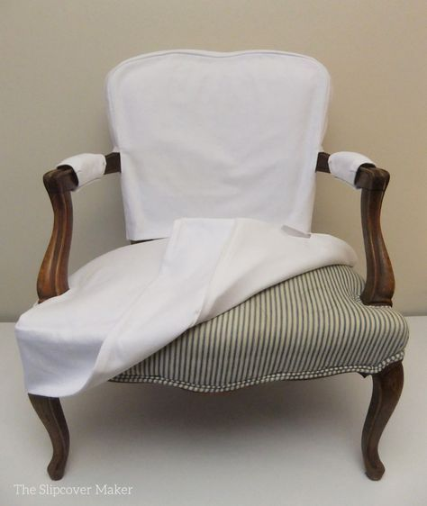 Simple White Denim Slipcover for French Chair is part of Slipcovers for chairs - Less is more was the vision for my customer's pair ofFrench chair slipcovers  No buttons, no ties or welt cord trim  Just simple, clean styling with hidden Velcro closures  Lovely! Theoldtickingupholstery is so cool looking but the dark stripe showed through thewhite denim  Adding a lining was an easy fix  It also gave themediumweight denim…