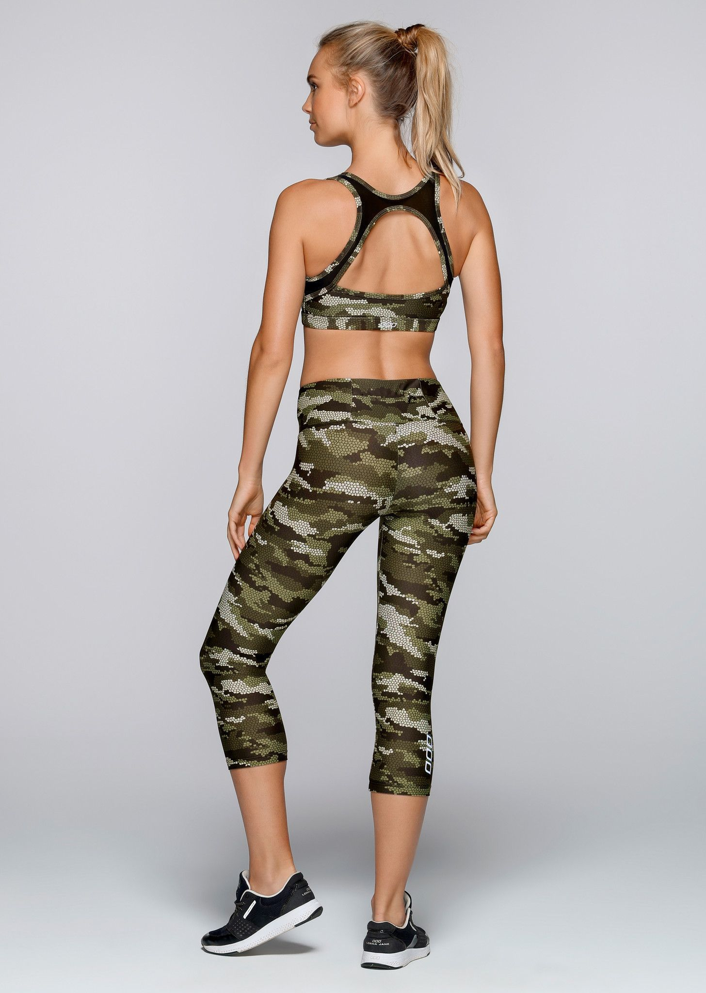 d9ed30552c Make a statement in this camo printed sports bra. The open back mesh panel  provides