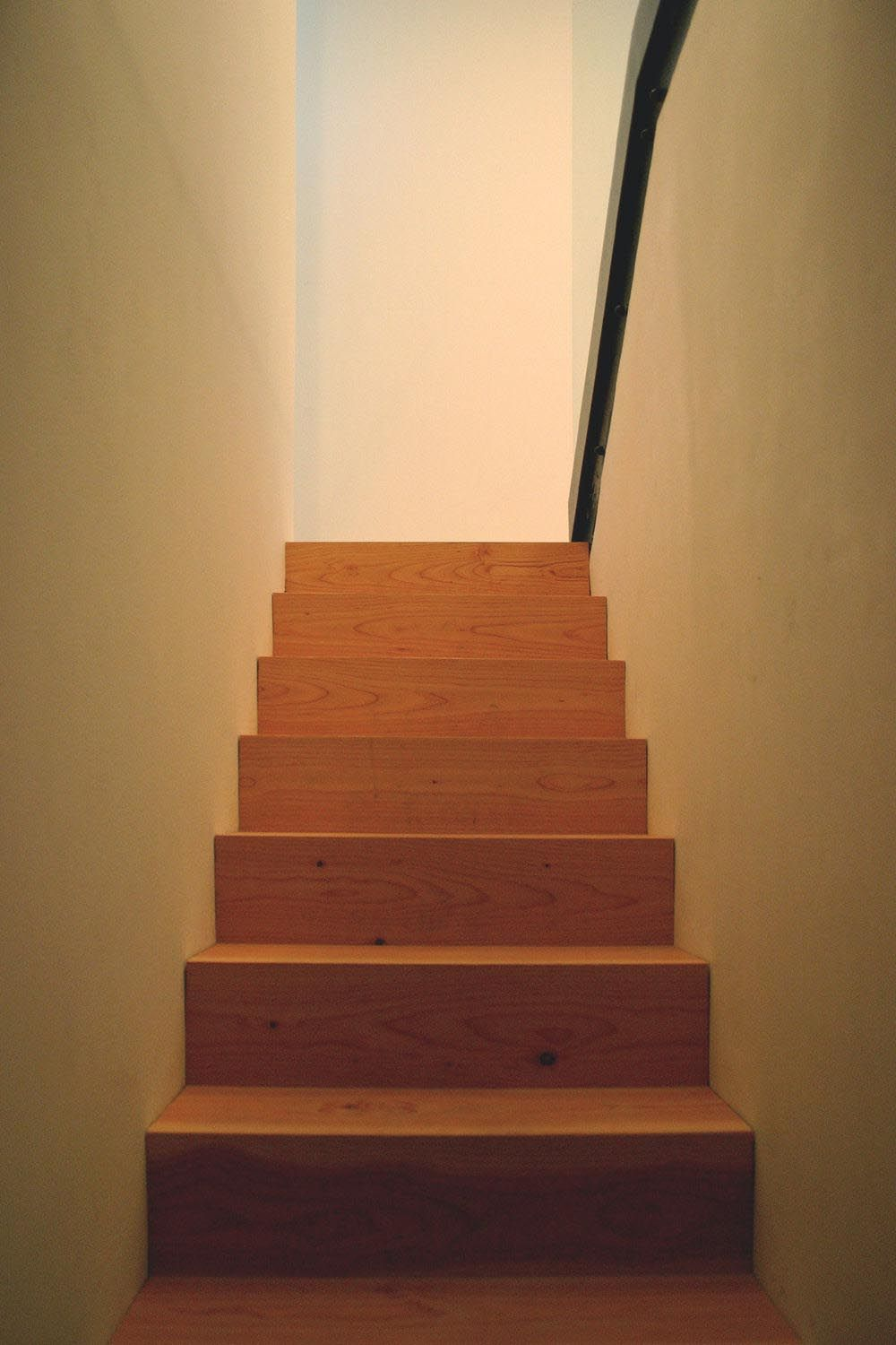 Simply Wooden Staircase Sandwiched Between Two Walls Idea