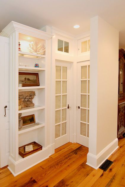 """Sizing trim: Baseboards 7% of wall height. IE: 8' wall = 7"""" baseboard. traditional living room by AMI Designs"""