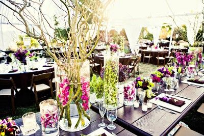 purple-green-pink-orchid-branch-centerpieces-submerged-flowers-brown-wood-estate-tables