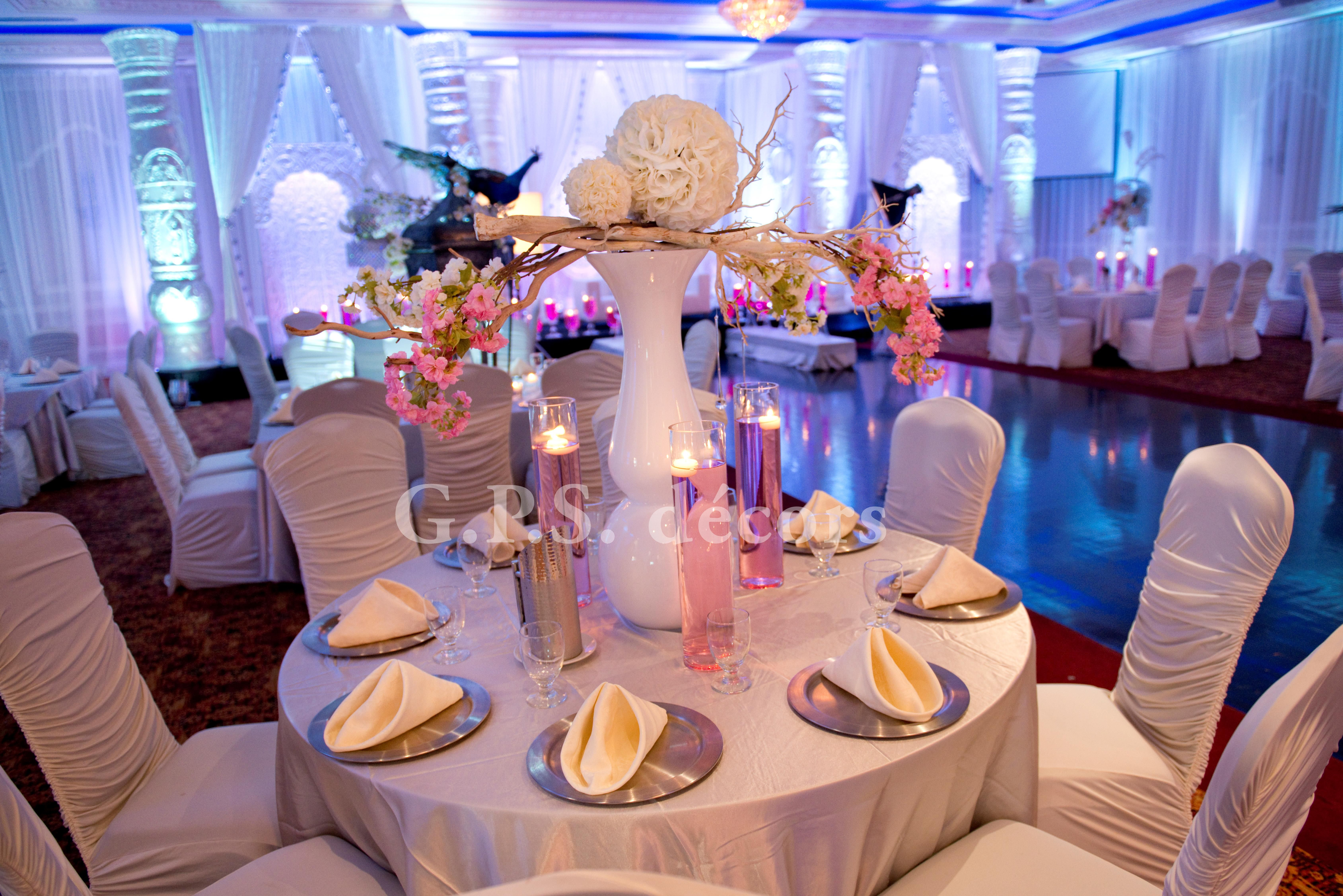 Table decorated with white flower balls and candles and a for Silver centerpieces for dining table