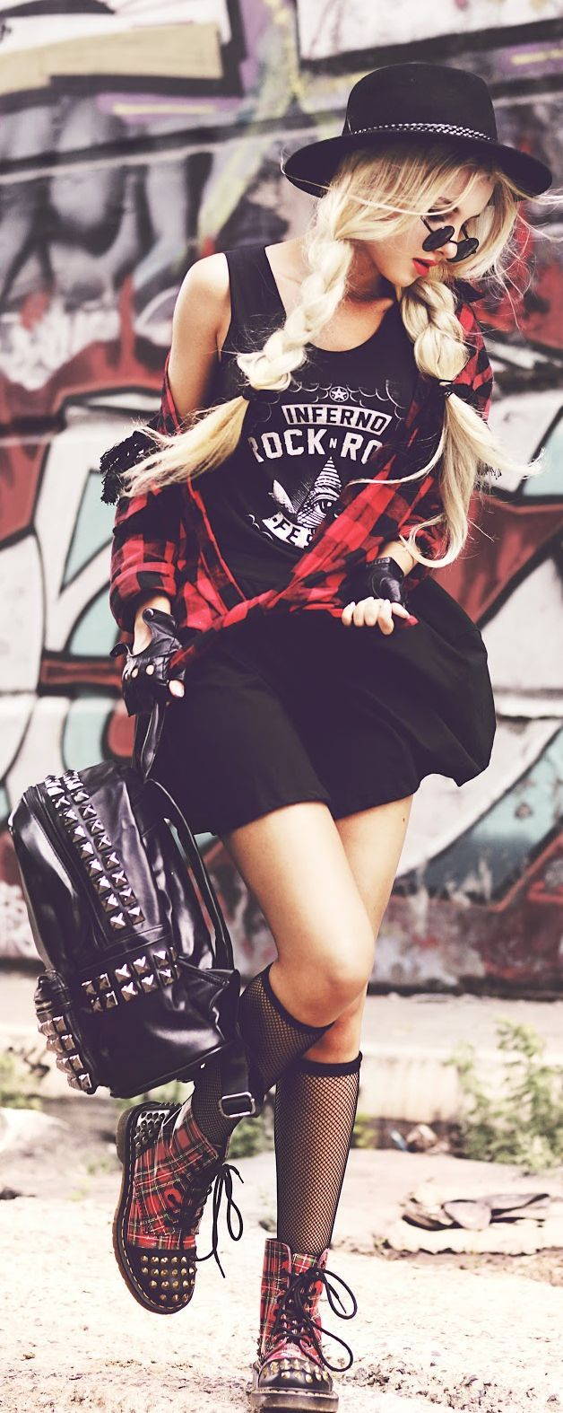 There is a lot going on here but def a feel I have gone for before.  I love the edgy tank mixed with the flannel.  Might not be everyone's style but the shades and hat add a stylish touch.  I also love studs and that backpack is outrageous but I am into it
