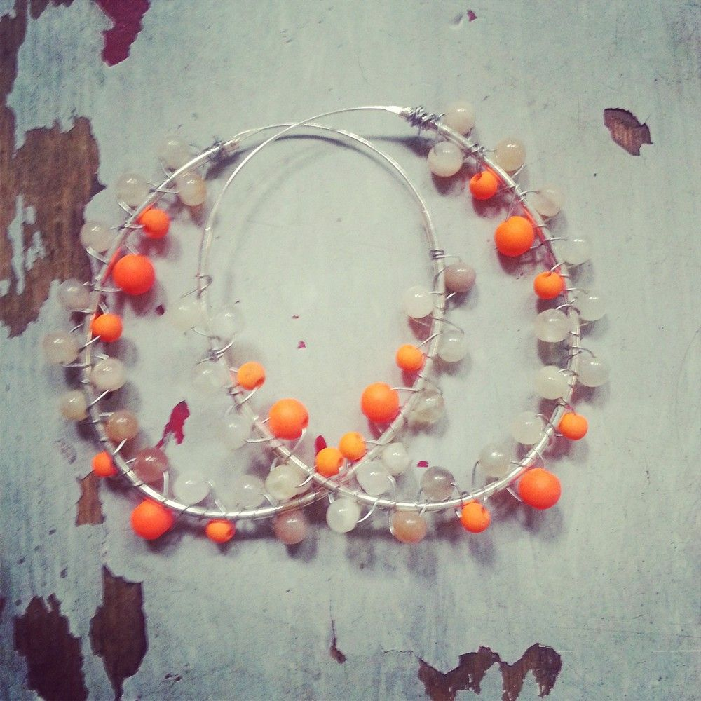 5 cm oval loops made of agate beads and neon orange beads on silver sterling loop.