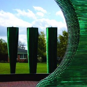 Presence of Seven, 2001, This is a large outdoor installation of seven stacked glass elements of varying sizes and forms designed and made for this particular location on a university campus. Allegheny College, Pennsylvania, 2001  Danny Lane