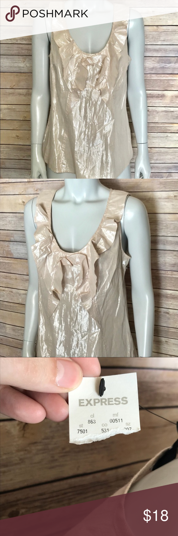 a8a057fe3337d  express  shimmery blush colored blouse Sleeveless scoop neck top is a  metallic champagne color. Ruffles along neckline and down middle.