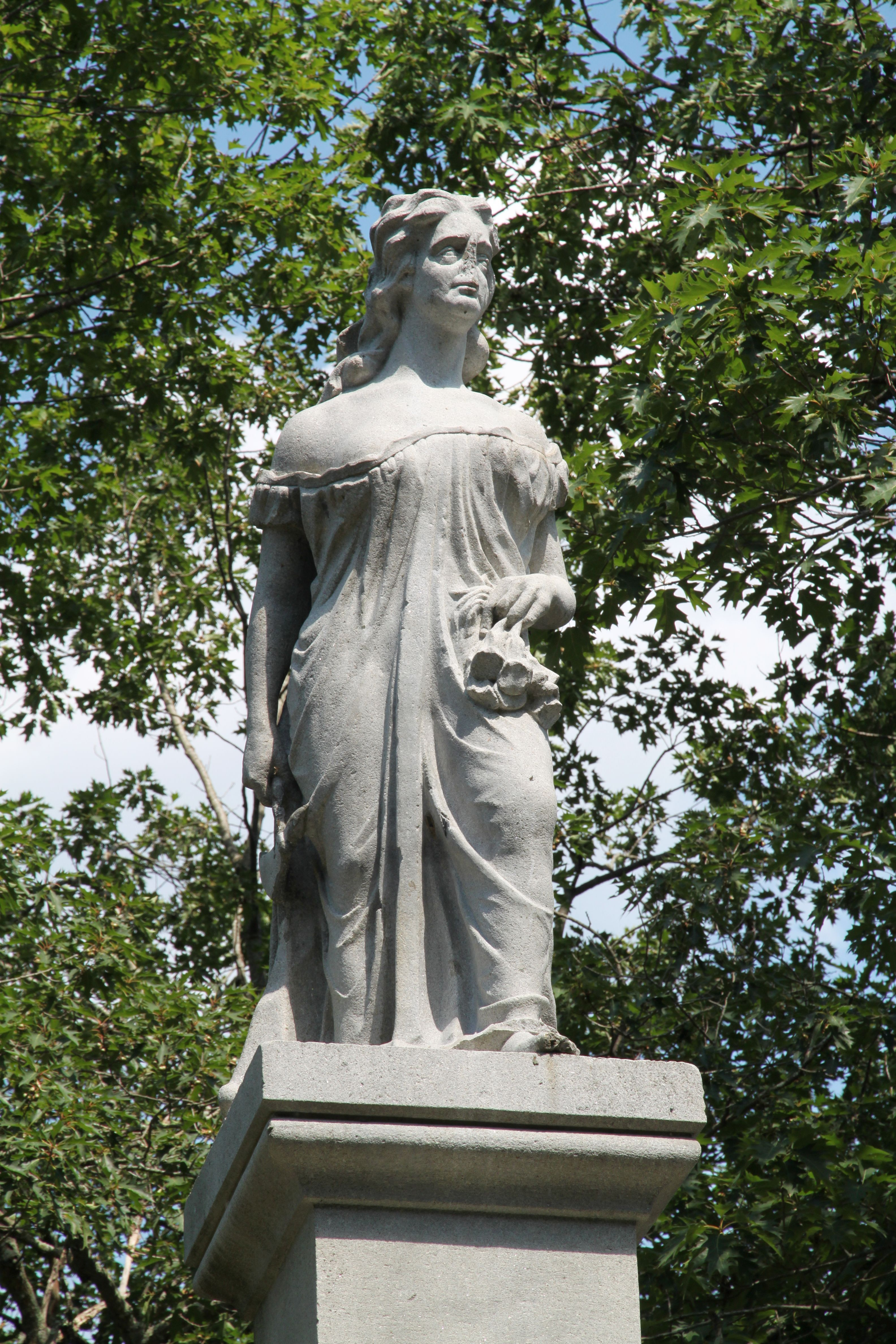 In 1874 this monument was erected in her memory on the site of the massacre, believed to be the first statue of a woman erected in this country.  The first Duston memorial actually executed was sculpted by William Andrews, a marble worker from Lowell, Massachusetts. It was erected in 1874 on the island in Boscawen, New Hampshire, where Duston killed her captors.  In her right hand is a hatchet, in her left a mass of Indian scalps. Vandals have shot off Hannah's nose.