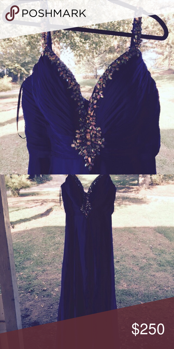 Alyce Prom dress size 12 Beautiful sapphire blue prom dress! Worn once for maybe 2 hours. Has a slit up the leg so it would be wonderful to wear for pageants too! Size 12. Has iridescent stones lining the chest and on both straps. Dresses Prom