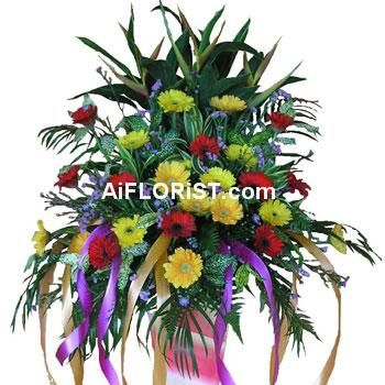 Colourful Mixed Arrangement Of Gerberas Heliconia To Bring Cheers To A Meaningful Occasion With Images Online Florist Flower Arrangements Funeral Flowers