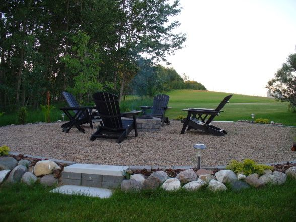 I like the idea of having the fire pit on a pea gravel