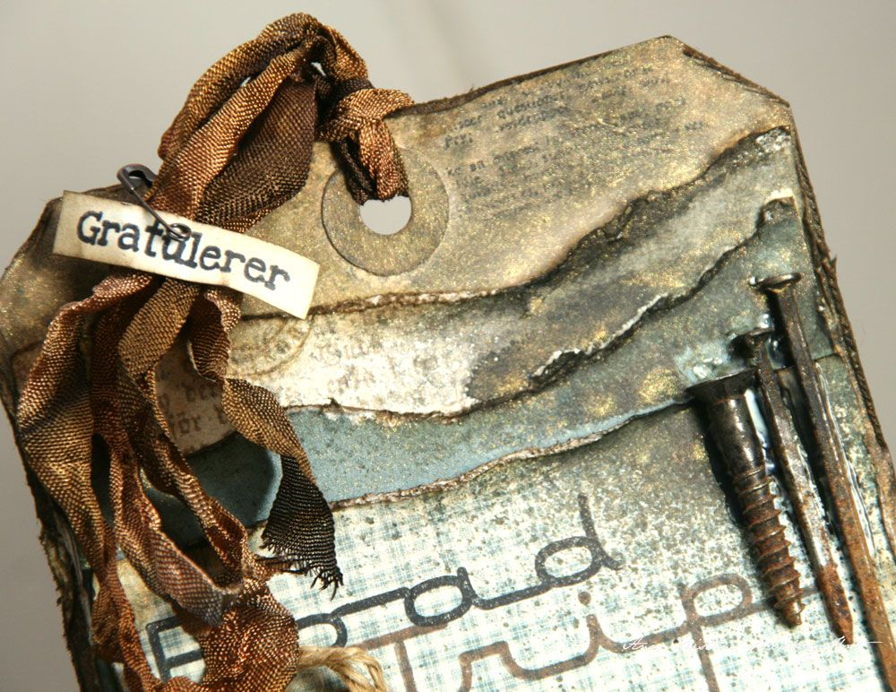 Anne Kristine:  A very distressed vintage look on this tag with layers of torn paper.  from Anne's Paper Fun