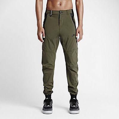 463af72b159f NWT Nike Tech Woven 2.0 Men s CUFFED Pants Cargo Khaki Black 746024 325 SZ  L 34 Clothing