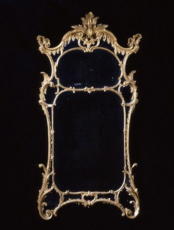 "A Magnificent George II Carved Giltwood Pier Mirror in the Manner of William and John Linnell,   CIRCA 1755,   Height: 84"" Width: 42"" - The central plates enclosed by shaped border glass, all set within a finely carved frame incorporating foliate motifs; the cresting hung with acanthus leaves, centered by a foliate plume cartouche."