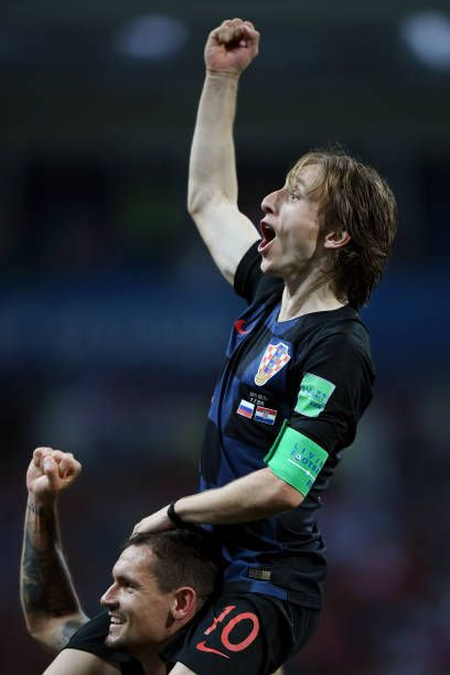 Dejan Lovren of Croatia and Luka Modric of Croatia celebrate following their sides victory in the 2018 FIFA World Cup Russia Quarter Final match...
