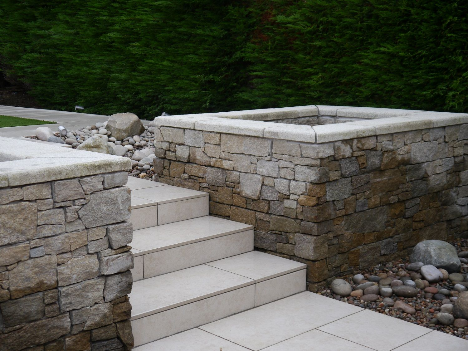 Coping Stones Provide A Stylish Solution To Finish Or Top A Wall They Perform A Vital Protective Role In Prevent Coping Stone Sloped Garden Natural Stone Wall