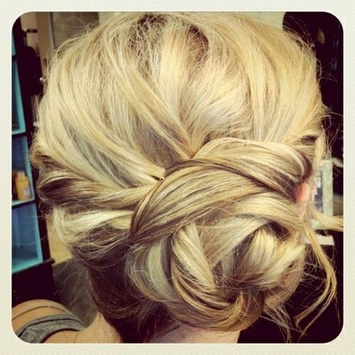One side braid twist into a bun. Use bobby pins to shape and secure.