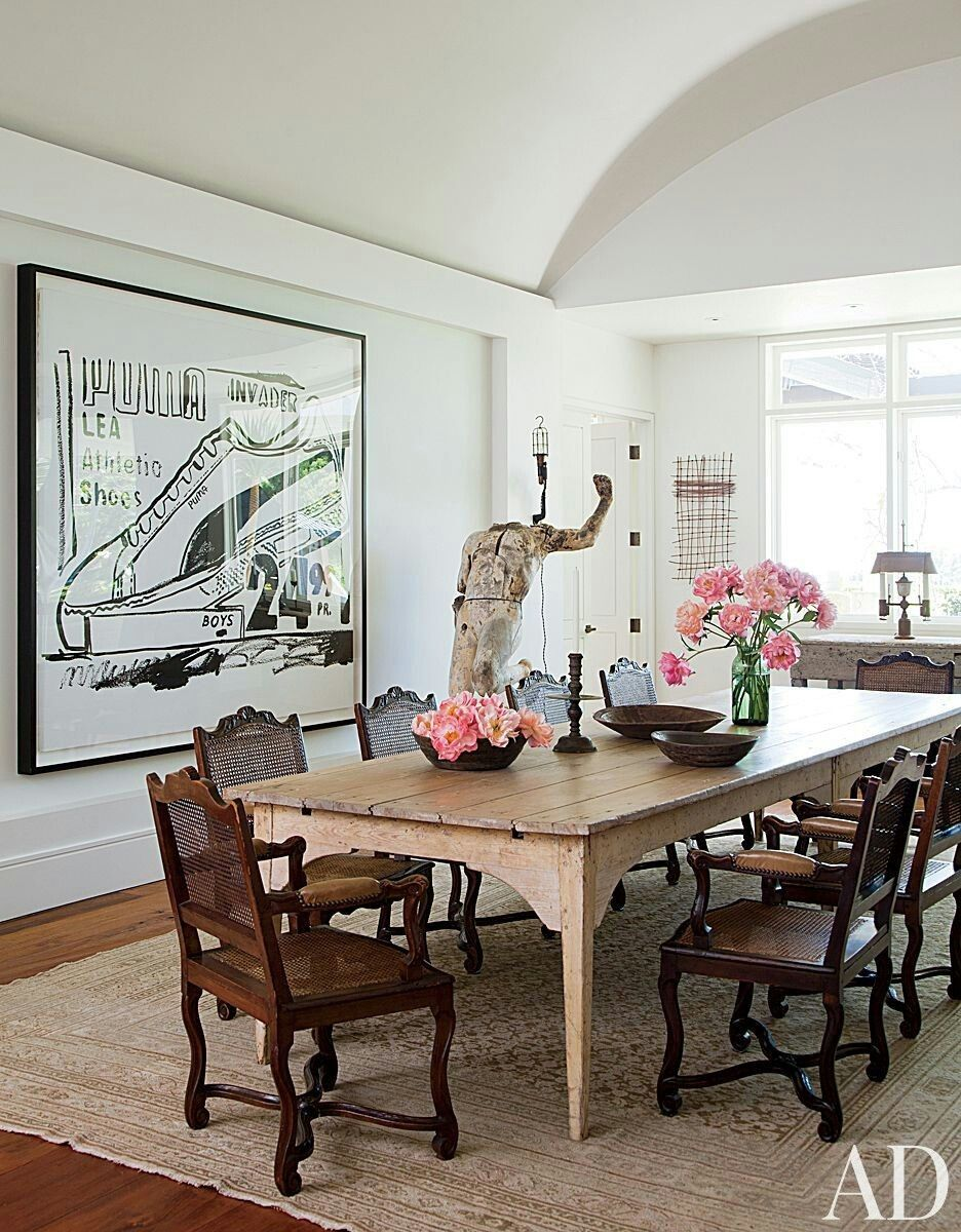 Jennifer aniston home interior antique french cane chairs surround a thcentury farm table in