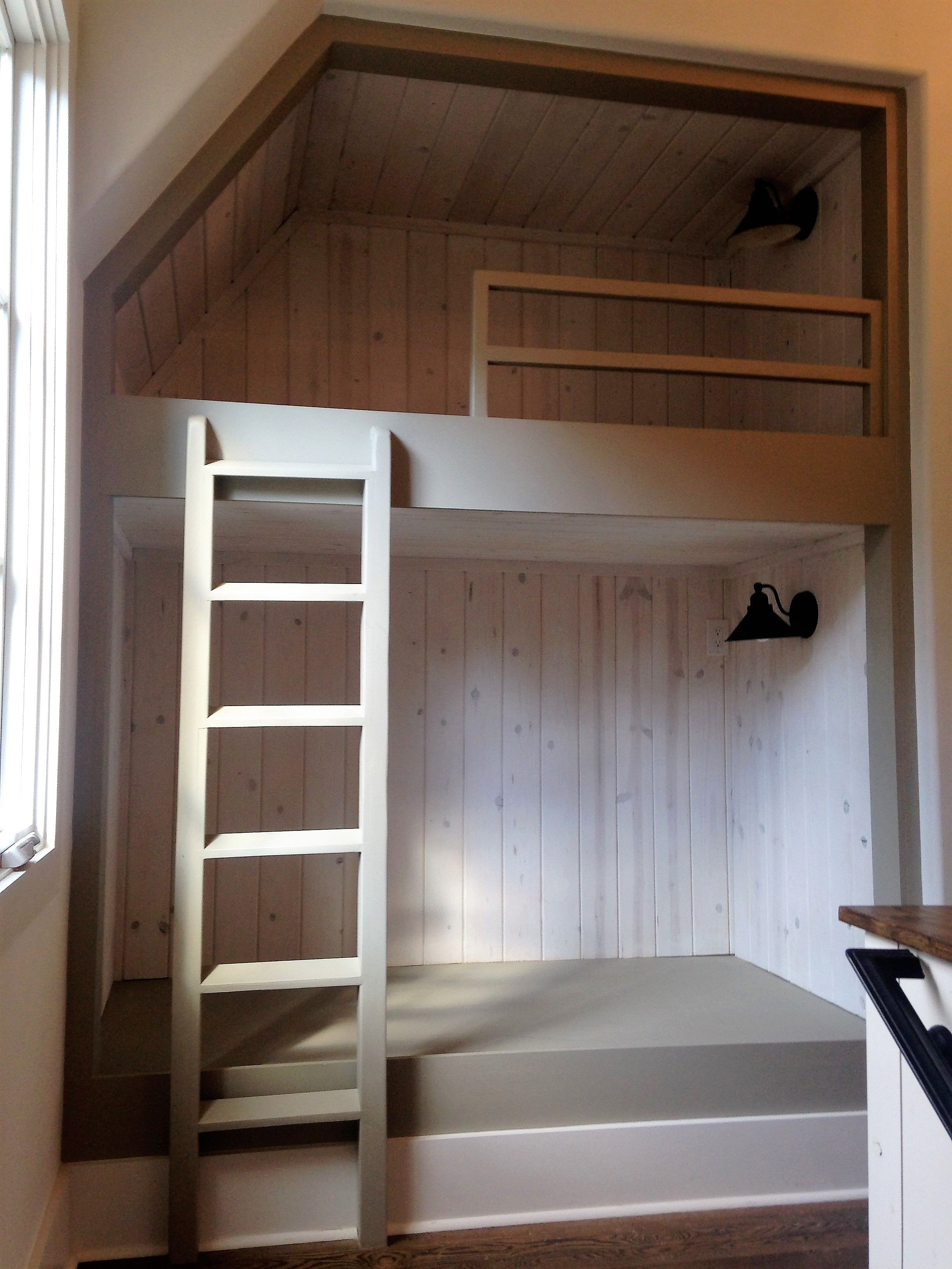 At the top of the stairs is a built in bunk bed. Perfect